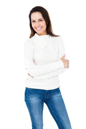 Smiling woman crossing arms