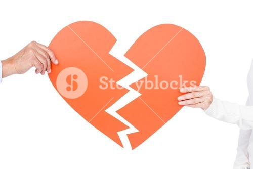 Couple holding broken heart