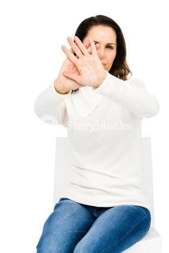 Unhappy woman hiding her face with hands