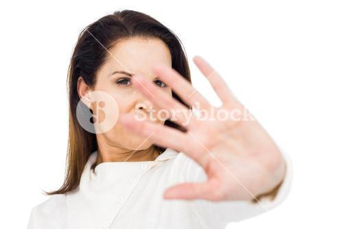 Unhappy woman hiding her face with hand