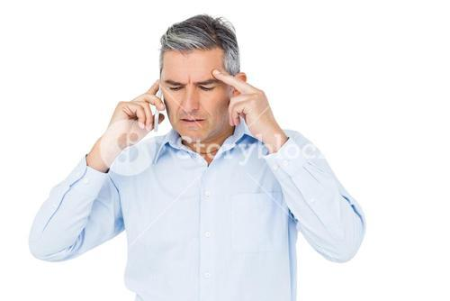 Concerned businessman phone calling
