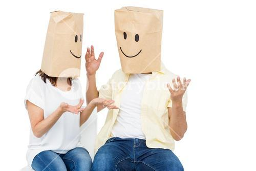 Couple covering their faces with paper bag