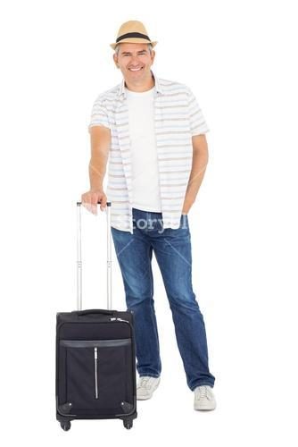 Handsome man posing with baggage