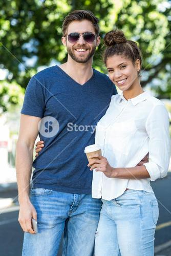 Hip couple smiling at the camera