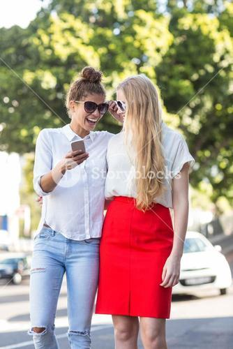 Hip woman looking at smartphone