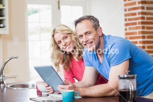 Cute couple using tablet