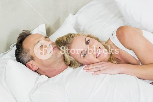 Cute couple cuddling in bed