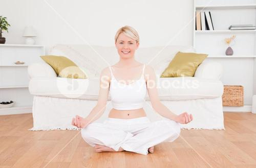Delighted blonde woman practicing yoga