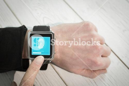 Composite image of businesswoman using a smart watch