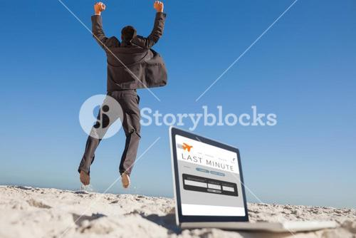 Composite image of victorious businessman jumping leaving his laptop