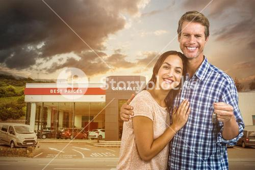 Composite image of portrait of happy couple with keys
