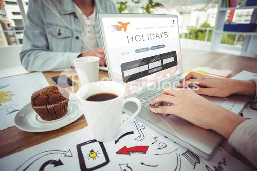 Composite image of creative business team working together