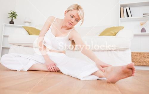 Delighted woman doing fitness exercises