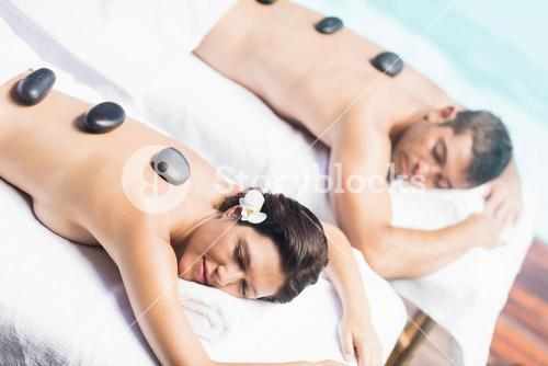 Couple getting a hot stone massage