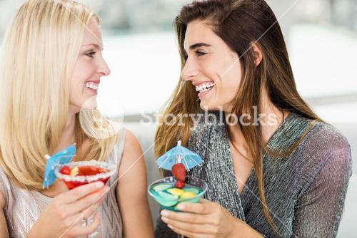 Close-up of beautiful women having mocktail