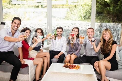 Group of friends having cocktail drinks