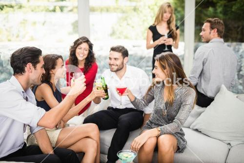 Group of friends talking and having drinks