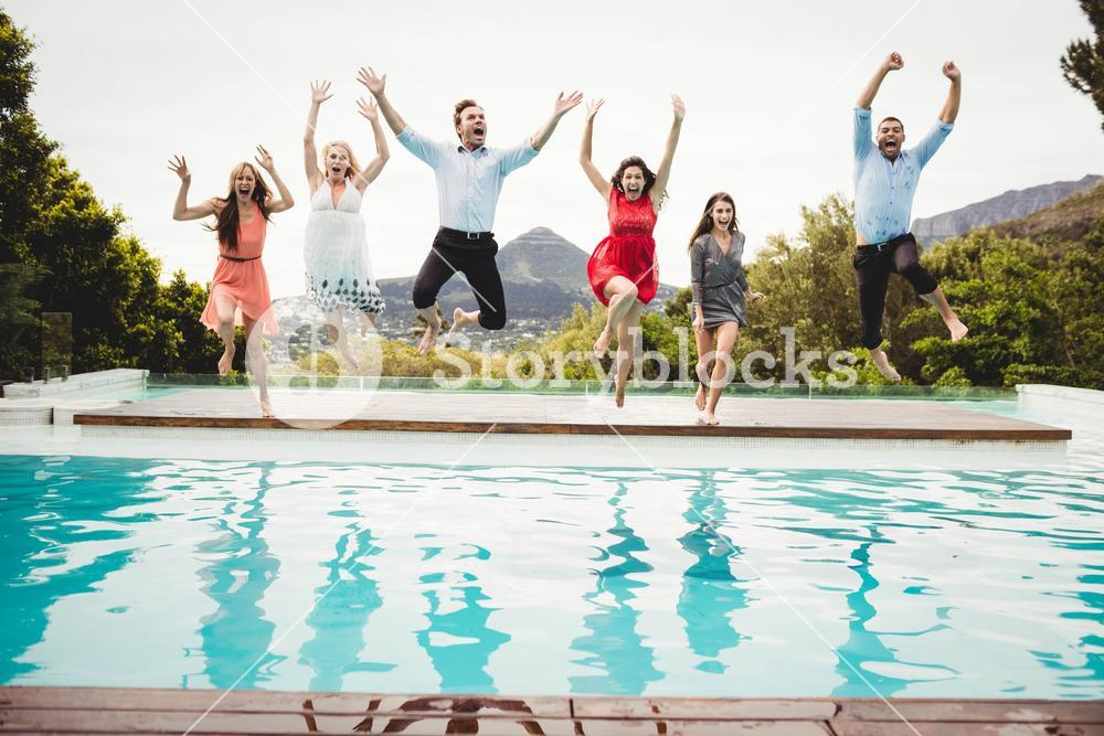 Young friends having fun at swimming pool