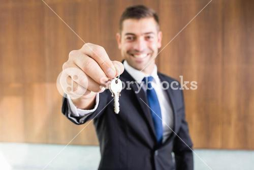 Real-estate agent giving keys