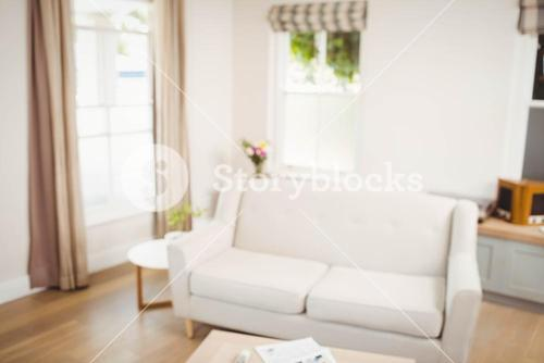 Empty living room with sofa and table