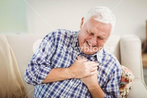 Senior man getting chest pain