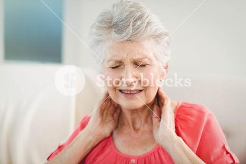 Senior woman suffering from neck pain