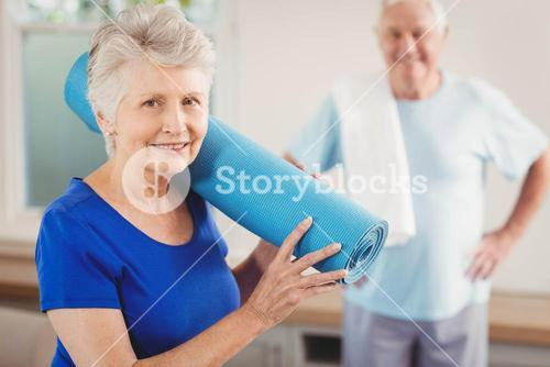 Senior couple packing up after workout
