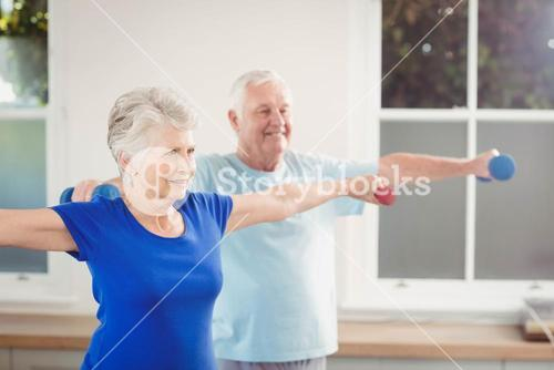 Senior couple performing stretching exercise