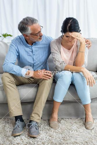 Therapist consoling a woman