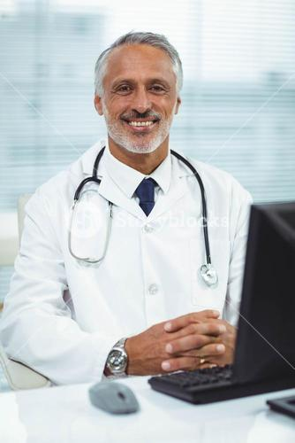 Doctor working on his computer