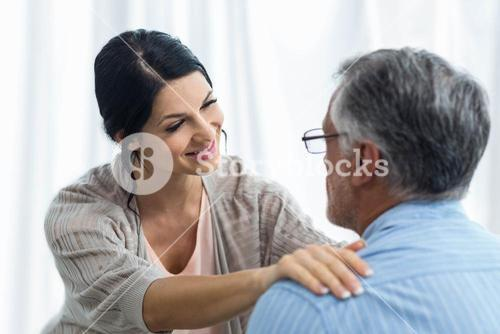 Female doctor consoling a man