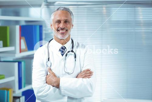 Doctor standing with arms crossed