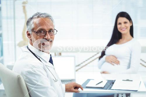 Pregnant woman sitting at clinic for health checkup