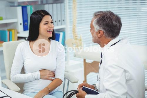 Pregnant woman talking to doctor