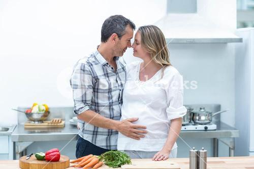 Man face to face with pregnant woman