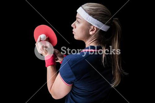 Female athlete playing ping pong