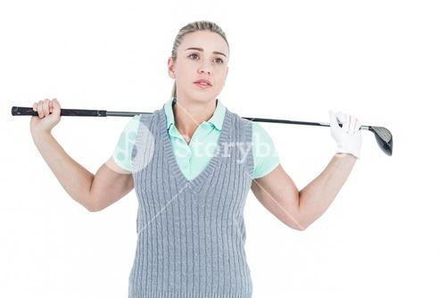 Pretty blonde posing with golf equipment