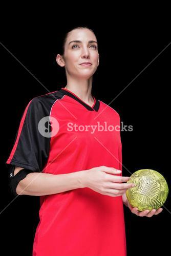 Female athlete holding a hand ball