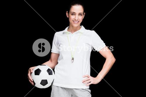 Female athlete holding a soccer ball