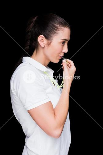 Female athlete blowing a whistle