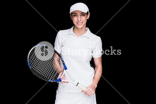 Female athlete posing with tennis racket