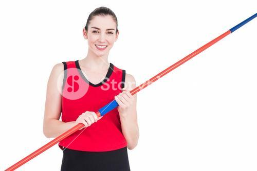 Female athlete holding a javelin