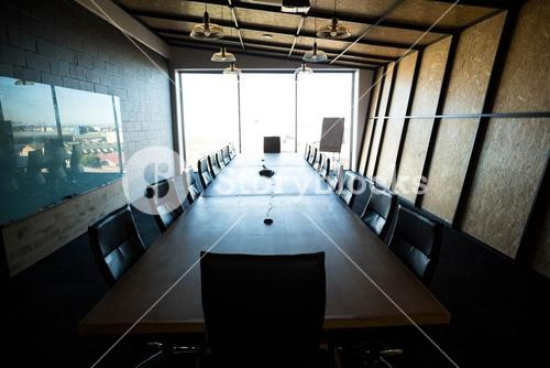 An empty modern conference room and conference table in office