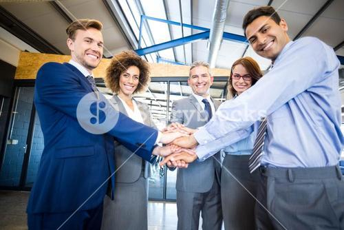 Businesspeople hands stacked over each other
