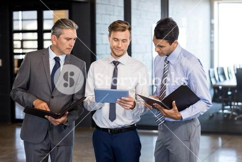 Business team interact using digital tablet and organizer