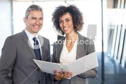 Businessman and colleague with documents