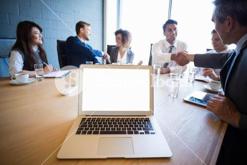 Businesspeople having a discussion in conference room