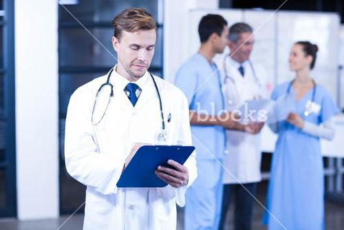 Doctor writing a medical report