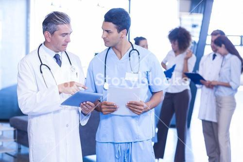 Doctor examining medical report and having a discussion