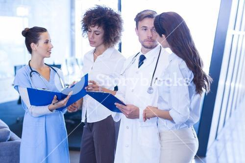 Doctors looking at medical report
